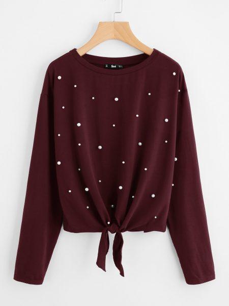 Пример того, как можно красиво украсить свитер бусинами